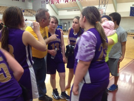 Lady Warriors coach Brad King talks to the six-person team during a break.