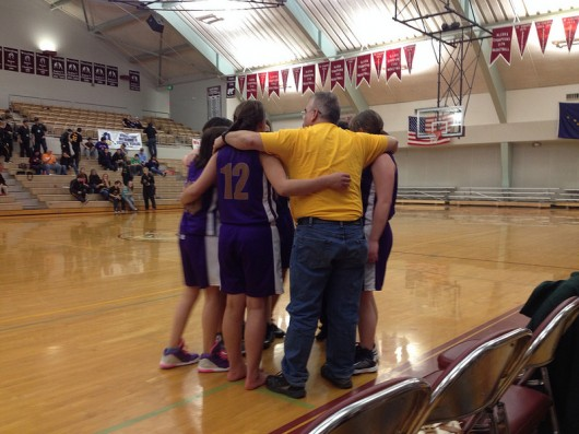 The team huddles during a time-out.