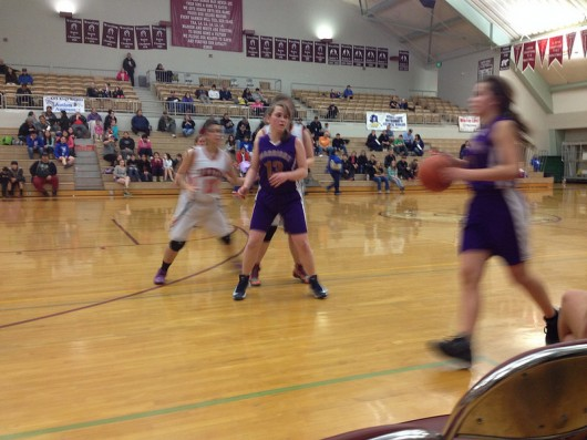 Andrea Cook dribbles past Courtney King in the team's game against Yakutat.