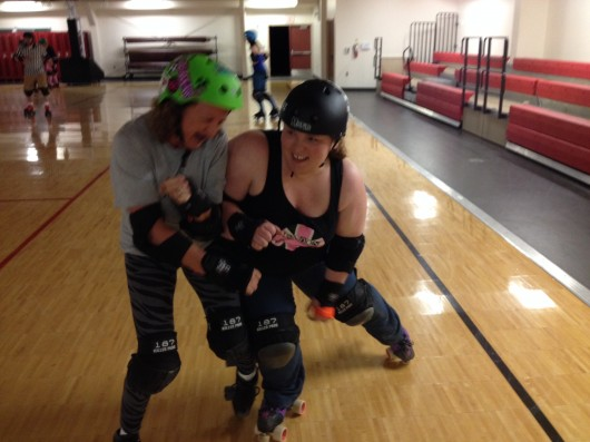 Lyrissa Hammer and Tara Miller at a recent Rollergirls practice.