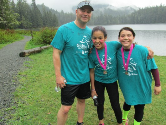 Chad Lawler, a Girls on the Run coach, with Jasmine Stevens and Jaat Haana Timmerman.