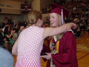 Valedictorian Hayley Jo Nichols receives her diploma from teach Leigh Woodward
