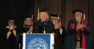 Evon Zerbetz, center, receives her honorary doctorate on Saturday.