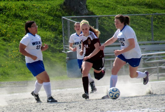 Ketchikan's Angel Spurgeon tries to keep the ball away from the Sitka Wolves.