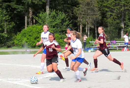Tia Simpson, Nedalyn Gonzales, and Melody Jacksch of the Ketchikan Lady Kings JV compete against the Sitka Wolves.