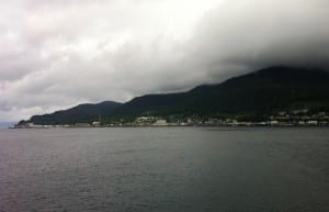 The City of Ketchikan is seen from the water on a cloudy day.