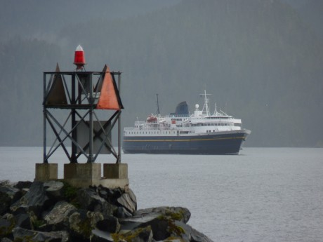 The ferry Malaspina makes a rare visit to waters off downtown Sitka during the 2010 Alaska Day celebration. A state transportation plan would route ferries to a new terminal across Baranof Island at the end of a new road. (Ed Schoenfeld/CoastAlaska News)