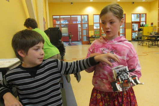 Evie Posey and Mason Baxter explain what their EV3 robot can do.