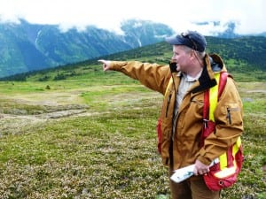 Seabridge Gold's Brent Murphy points to a valley to be dammed to hold tailings from the KSM mine during a July tour. The project just won federal environmental approval. (Ed Schoenfeld/CoastAlaska News)