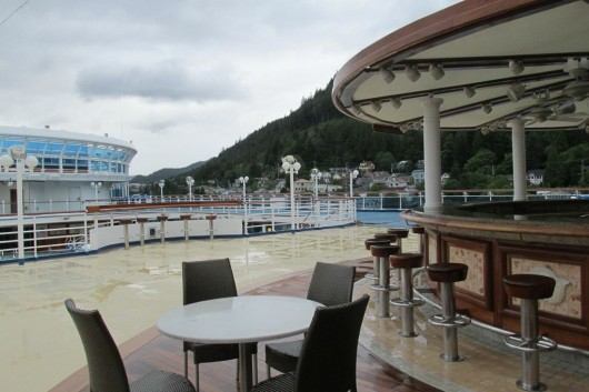 A bar next to a pool on the Crown Princess.