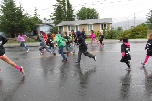 Kids compete in a fun run to start out the day.