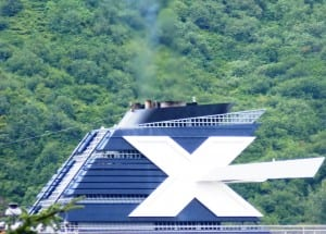 A Celebrity Cruise Line ship sails into Juneau in 2012 with emissions coming out of its stack. New pollution-control equipment being installed on Alaska-bound and other ships will reduce the emissions plume. (Ed Schoenfeld/CoastAlaska News)