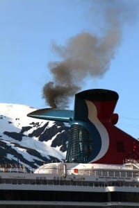 Smoke pours out of the smokestack of the Carnival Spirit as it fires up its engines. (Courtesy Ground Truth Trekking)