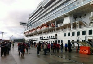 Tourists disembark from the Ruby Princess this spring, beginning the 2015 tour season in Ketchikan. The Ruby is permitted to discharge graywater while docked. (KRBD file photo).