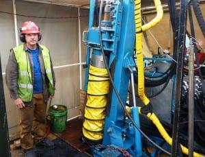 A drilling-crew member poses during a break at Seabridge Gold's KSM Mine. (Ed Schoenfeld/CoastAlaska News)