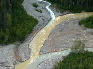 Sulphurets Creek, which drains naturally occurring rusty water from the KSM mine prospect, enters Mitchell Creek upstream from Southeast Alaska. Tribal officials worry mining will send polluted water into British Columbia rivers that flow into Alaska. KSM officials say their pollution-control designs will keep that from happening. (Photo by Ed Schoenfeld/CoastAlaska News)