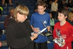 "The Coffman Cove ""Timber Wolves"" checking the components for their robots."
