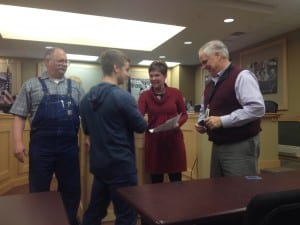 Trevin Tavares receives his NCCER certificate at the Ketchikan School Board meeting January 13, 2016.