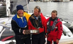 Al Hughes, Matt Steverson and Graeme Esarey take first-place in the Race To Alaska. The crew crossed the finish line in Ketchikan, Alaska at 12:55pm on Friday, June 12, 2015. (KRBD File Photo)