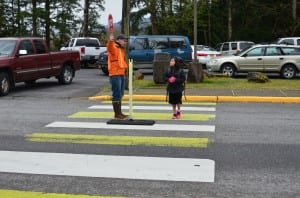 Peter Epler helps a Houghtling student cross safely Monday morning.