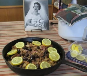 Kathy Bolling's Greek lemon chicken, with a photo of her mother in the background. (Photo by Leila Kheiry)