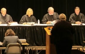 The Alaska Supreme Court listens to state attorney Mary Lundquist during the Supreme Court live event. (KRBD File Photo)