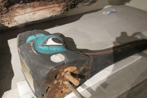 A large fragment from the Chief Kyan Totem Pole showing a metal rod repair.