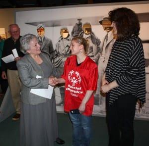 Foundation advisory board chair Christa Bruce, left, awards $2,500 to Ketchikan's Special Olympics program. (Photo courtesy Ketchikan Community Foundation)
