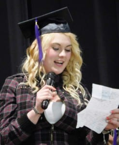 A Revilla High School graduate reads a letter of thanks during the June 1graduation ceremony. (Ed Schoenfeld/CoastAlaska News)