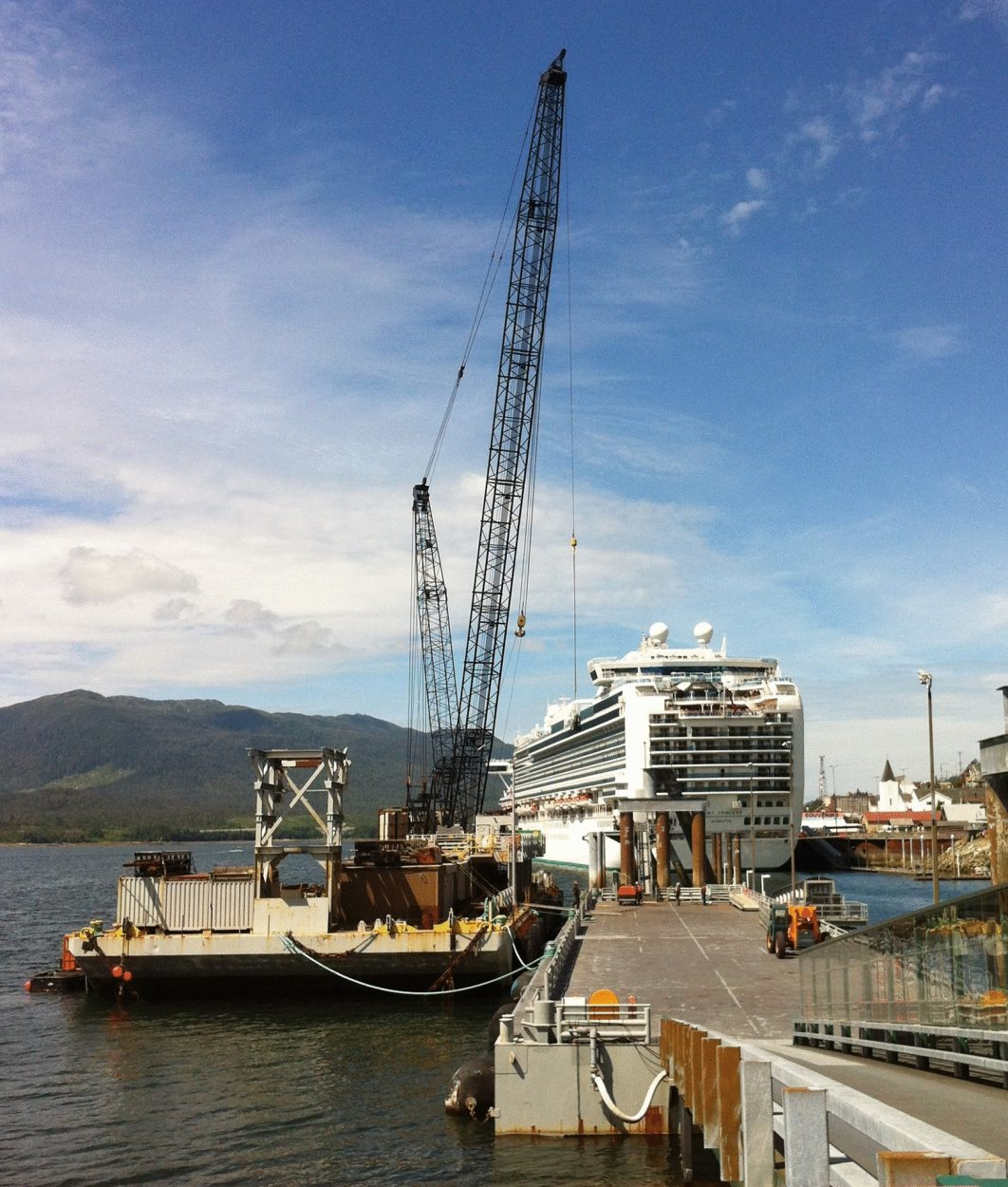 The repair barge for Turnagain Marine Construction is seen at Ketchikan's Berth 3, damaged when the cruise ship Infinity hit the dock on June 3rd. (Photo by Leila Kheiry)