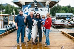 "From left are Brian Brissette, with a hook in his finger, Bill ""Skip"" Pattison, Misty Pattison,  Bryson Brissette and Louise Pattison, standing with Misty's winning king salmon. (Photo by Stephanie Brissette)"