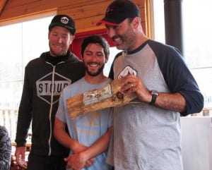 First-place Team MAD Dog Adventures show off the $10,000 prize, nailed to a piece of wood. The team members are Captain Randy Miller, holding the prize money, Ian Andrewes and Colin Dunphy. (Photo by Leila Kheiry)