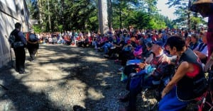 Richard Peterson of Kasaan, Central Council Tlingit and Haida President, addressing the hundreds of guests in front of the Whalehouse (copyrighted photo by Marijane Armour used with permission).