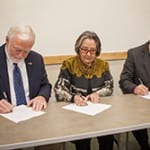 UAS Chancellor Richard A. Caulfield, SHI President Rosita Worl, and IAIA President Robert Martin signing the MOA.