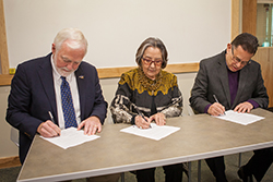 UAS Chancellor Richard A. Caulfield, SHI President Rosita Worl, and IAIA President Robert Martin signing the MOA.
