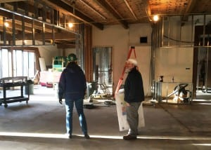 Anita Maxwell and Tim Whiteley walk through the Tongass Historical Museum's main floor, which is under renovation. (Photo by Leila Kheiry)