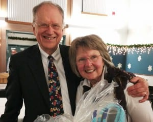Retiring Doctor David Johnson and his wife, Jenny, are seen at the PeaceHealth Ketchikan holiday party. (PeaceHealth photo)