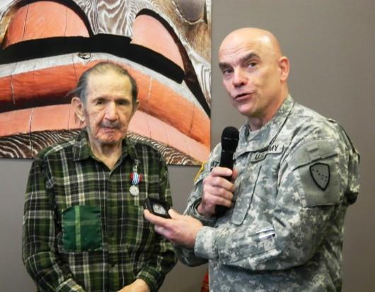 ATG veteran Henry Neligan receives his honorable discharge in 2013 from Maj. Gen. Thomas Katkus.
