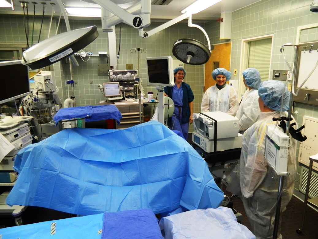 Hospital operating room - A Group Of Visitors Tours A Crowded Operating Room