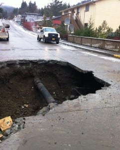 A section of repaired water pipe is seen on Baranof Avenue after the old pipe broke and washed out the fill under the street in 2013. (KRBD file photo by Leila Kheiry)