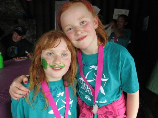 Sisters Maggie and Lena Hert are two Girls on the Run. Maggie says bullying is a struggle for  11-year-olds.
