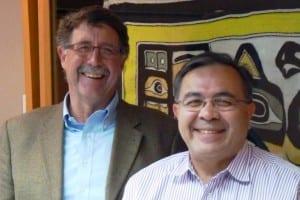 Sealaska VP Rick Harris and CEO Chris McNeil pose at the corporatin's board room. (Ed Schoenfeld/CoastAlaska)