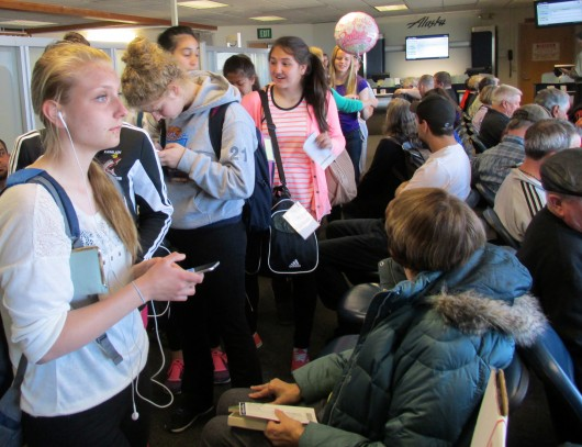 Melody Jacksch and the other Lady Kings at the Sitka airport, waiting to go back home to Ketchikan.