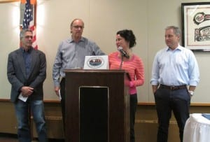 Sen. Lesil McGuire speaks during the special Ketchikan Chamber of Commerce event on Monday, just before Gov. Sean Parnell, right, signed SB99 into law.