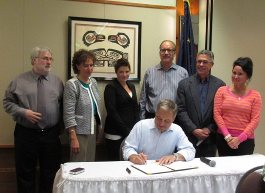 Parnell signs SB99 to allow POW mine loans