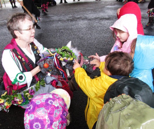 Preschool children attending Monday's Morris Dance performance pet a hobby horse, which is part of the English folk dance's tradition.
