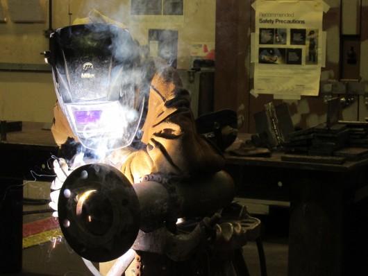 Cat Wong welding a pipe for an Alaska Marine Highway ferry.