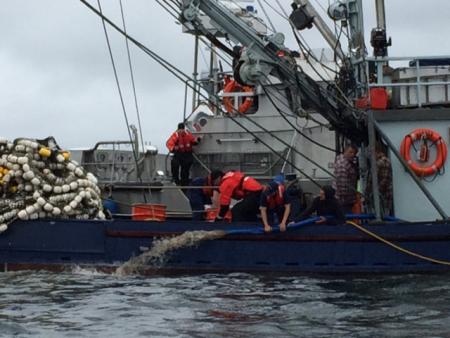 Coast Guard Station Ketchikan boarding team members help the crew of the fishing vessel Vernon dewater their engine room near Ketchikan on Friday. (U.S. Coast Guard photo by Station Ketchikan)