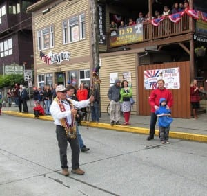 Grand Marshall Hall Anderson got out of the Fourth of July parade's lead car to wave at bystanders near Ketchikan's downtown tunnel.