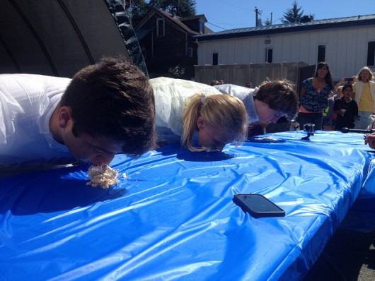 The three finalists for the young adult pie eating contest face off.